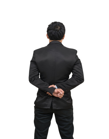 white body suit: Back side of a businessman with his hands clasped behind himself, Include clipping path Stock Photo