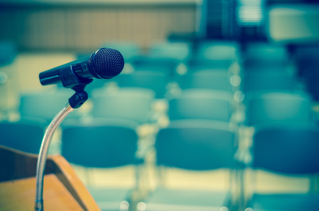 Microphone on the speech podium over the Abstract blurred photo of conference hall or seminar room background 免版税图像 - 52460620