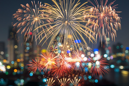 eve: Fantastic festive new years colorful fireworks on cityscape blurred photo bokeh in celebration night