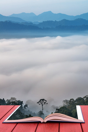 scenary: Conceptual book image of beautiful scenary of mist with mountain range at PanoenThung view point in Kaeng Krachan national park,Thailand