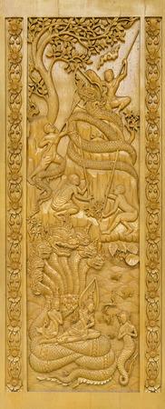public domain: Closeup Wooden mural of Wat Pak Khlong Makham Thao, Chainat province, Thailand,public domain Stock Photo