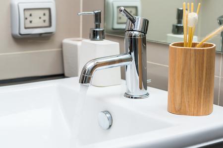 modern bathroom: Chrome faucet with washbasin in modern bathroom