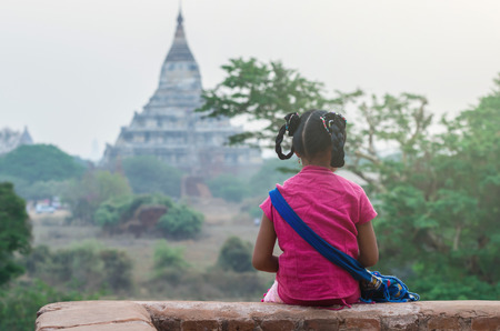 thanaka: Back side of Burmese girl with traditional thanaka on her face at bagan in Mandalay, Myanmar