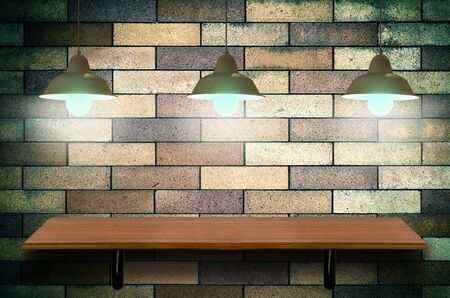 lighten: Empty top wooden shelves on brick wall with Lighten background.Product presentation concept