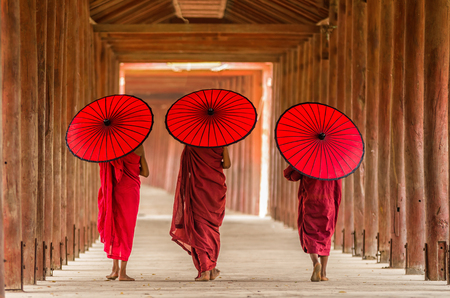 Back side of three Buddhist novice are walking in pagoda,myanmar