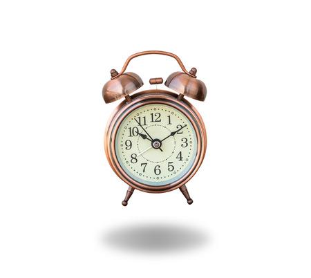 ringing: vintage alarm clock ringing on white background Stock Photo