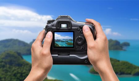 thong: Hands holding the camera which taking photo of Top view of Ang Thong National Marine Park with rainbow, Thailand