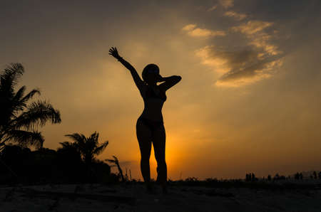oneself: silhouette of exercise or lazy action,stretch oneself or wormup Stock Photo