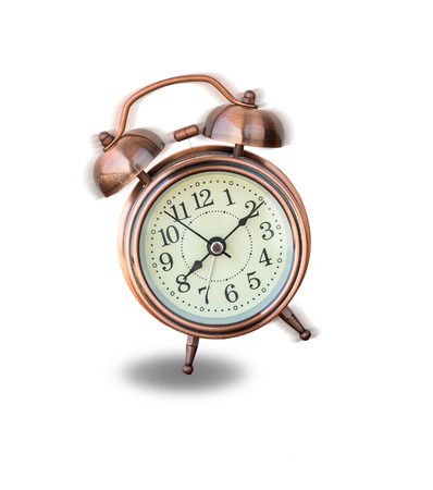 ringing: vintage alarm clock ringing on white background, include clipping path