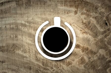 poweron: Coffee cup with power-on symbol over the wooden background. Energy and active concept