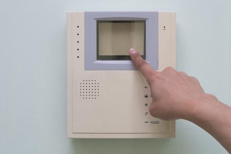pushing button: Human finger pushing button of video intercom equipment