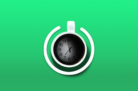 poweron: Coffee cup Look like power-on symbol with clock time over the green background. Energy and active concept Stock Photo