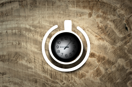 poweron: Coffee cup with power-on symbol with time over the wooden background. Energy and active concept
