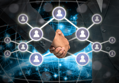 business media: Business handshake with Social media symbol over Internet network concept background Stock Photo