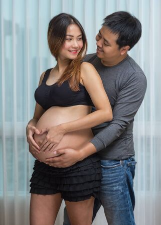asian pregnant: Asian Pregnant female with Lover, family concept Stock Photo