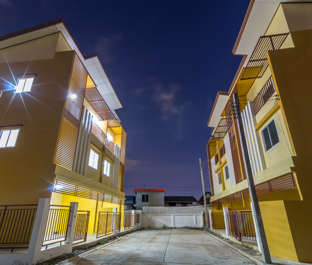 townhome: Exterior Townhome or Townhouse at twilight time