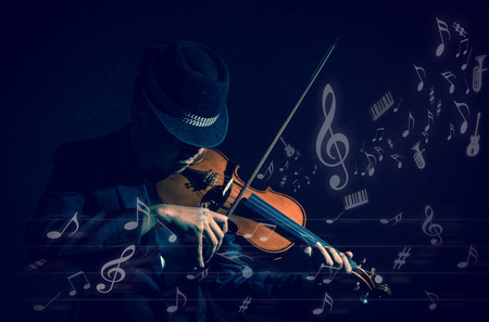woman violin: Violin player in dark studio with music notes or melody, Musical concept Stock Photo