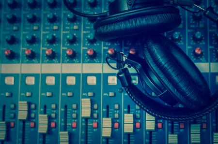 Top view of Earphone on mixer, music instrument concept
