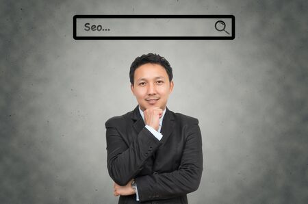url virtual: Asian businessman with browsing of Internet searching seo bar above the head on the wall background, Internet concept