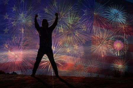 alzando la mano: silhouette of a man who show hands over the Multicolor Fireworks Celebrate over the United state of America USA flag background, Independence day concept Foto de archivo