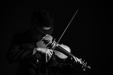 Violin player in dark studio, Musical concept
