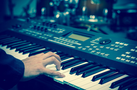 ivories: Closeup hands playing the keyboard or piano on brand music instrument background, music concept