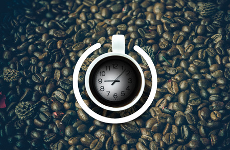 poweron: Coffee cup with power-on symbol and time over the coffee bean background. Energy and active concept Stock Photo