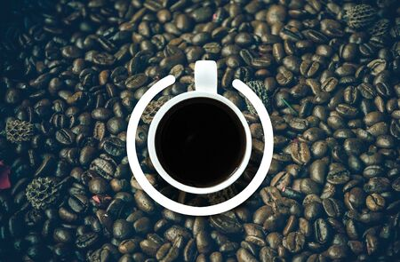 recuperation: Coffee cup with power-on symbol over the coffee bean background. Energy and active concept