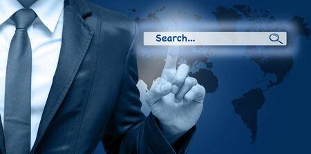 url virtual: Businessman touching the virtual searching bar, Internet concept