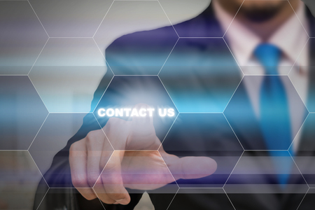 24x7: Businessman touching the Contact us icon on the Abstract blurred photo background, Business customer service concept