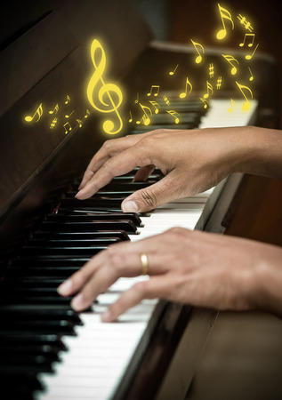 ivories: hands playing the piano with music melody,musical instrument