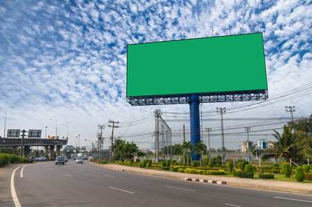 advertise: Blank billboard with green color background for new advertisement under the blue sky, advertise concept Stock Photo