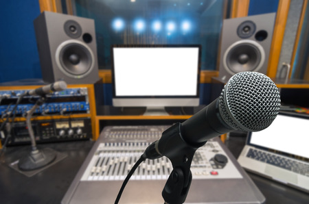 turn table: Microphone over the Abstract blurred photo of music studio recording room background, musical concept Stock Photo