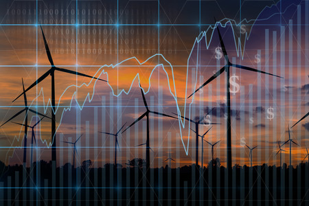 Trading graph on Wind turbine power generator at twilight time background,Business financial concept Foto de archivo