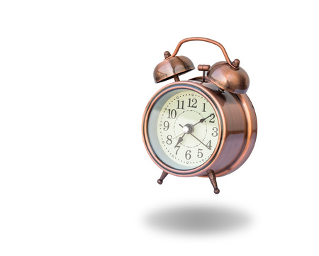 vibrating: vintage alarm clock ringing on white background, include clipping path