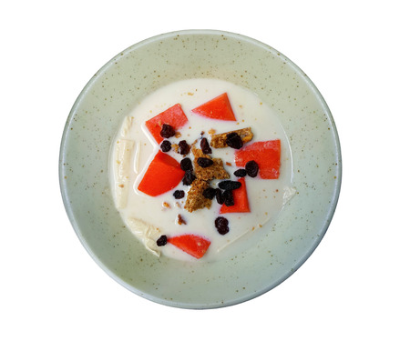 Breakfast food of Soybean milk with granola, currant mix with papaya in small bowl over white background, Top view of healthy food concept, include clipping path Stock Photo