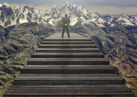 climbed: Businessman climbed on top of the stairs which can see Top view of mountains with snow and clouds,Success business and Ambitions concept