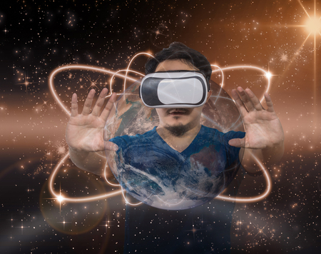 business game: Double exposure of Asian man wearing virtual reality over star with the earth background