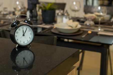 restaurant set with vintage clock at lunch time at Luxury Interior kitchen room background Stock Photo