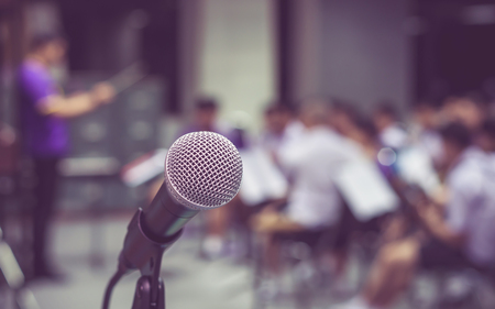concep: Microphone over the Abstract blurred photo of classic music band when rehearsal, musical concep, seminar meeting concept