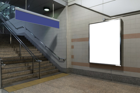 Blank billboard located in underground hall or subway for advertising, mockup concept, Low light speed shutter Banco de Imagens - 64702488