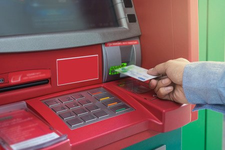 pin entry: Closeup of male hands using and with insert ATM card into bank machine for withdraw the money, business technology banking concept Stock Photo