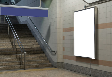 Blank billboard located in underground hall or subway for advertising, mockup concept, Low light speed shutter