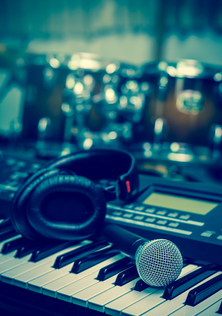 microphone on music keyboard with music brand blurred background, music instrument concpet