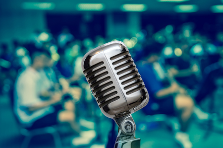 concep: Retro Microphone over the Abstract blurred photo of classic music band when rehearsal, musical concep, seminar meeting concept Stock Photo