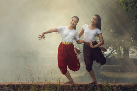 rehearse: Two Beautiful young girl Thai Dancing art, pantomime performances action of Thailand, khon is the main dramatic art form of Thailand Stock Photo