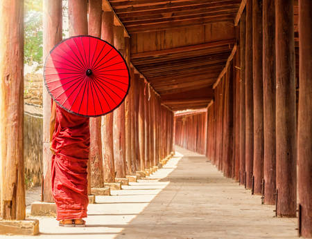 Back side of Buddhist novice standing in pagoda,myanmar Stock Photo