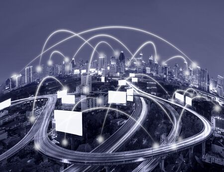 Network connection line between building over the top view of cityscape which can see the Elevated highway background, cool tone color, business network and connection concept