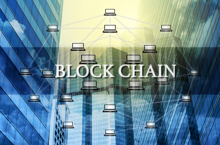 Block chain Text and Distributed computer network over the Modern business building glass of skyscrapers, Distributed ledger technology concept, Block chain Technology trend concept Banque d'images