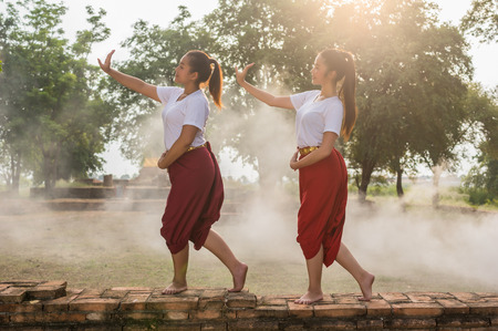thai dancing: Two Beautiful young girl Thai Dancing art, pantomime performances action of Thailand, khon is the main dramatic art form of Thailand Stock Photo